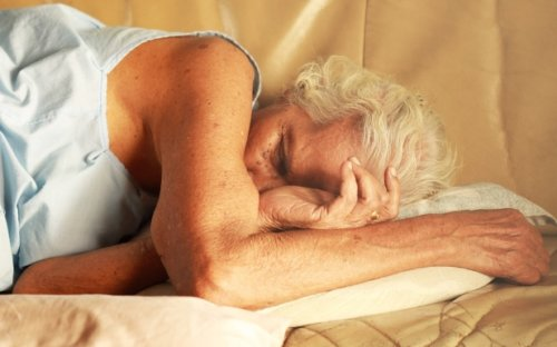 side sleeping senior woman